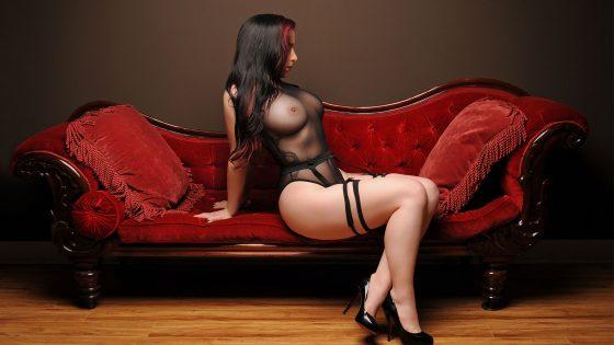 Erotic milking table massage artist posing in see through lingerie