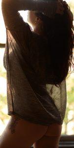 Chicago erotic massage artist Rachael Richards wearing a see-through sweater