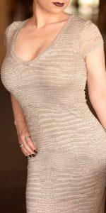 New York erotic massage artist Rachael Richards sexy pose in tight dress